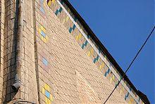 Облицовка плиткой городского фасада храма